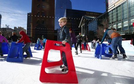 child skating using skate helper