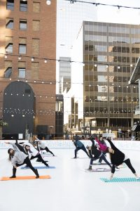 Snowga Yoga Downtown Denver Rink Skate